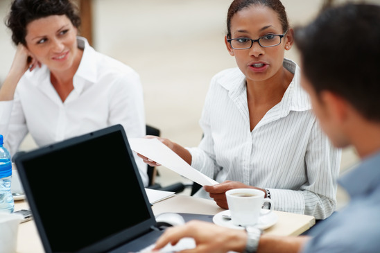 photodune-205295-african-american-woman-at-a-business-meeting-with-colleagues-xs
