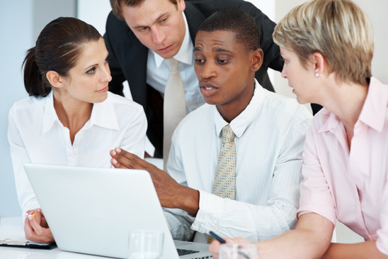 photodune-648881-young-businessman-discussing-working-ideas-with-associates-xs